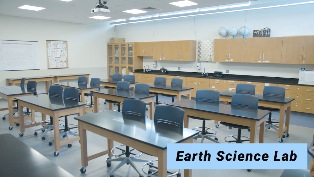 Photo of earth science lab room showing empty desks.