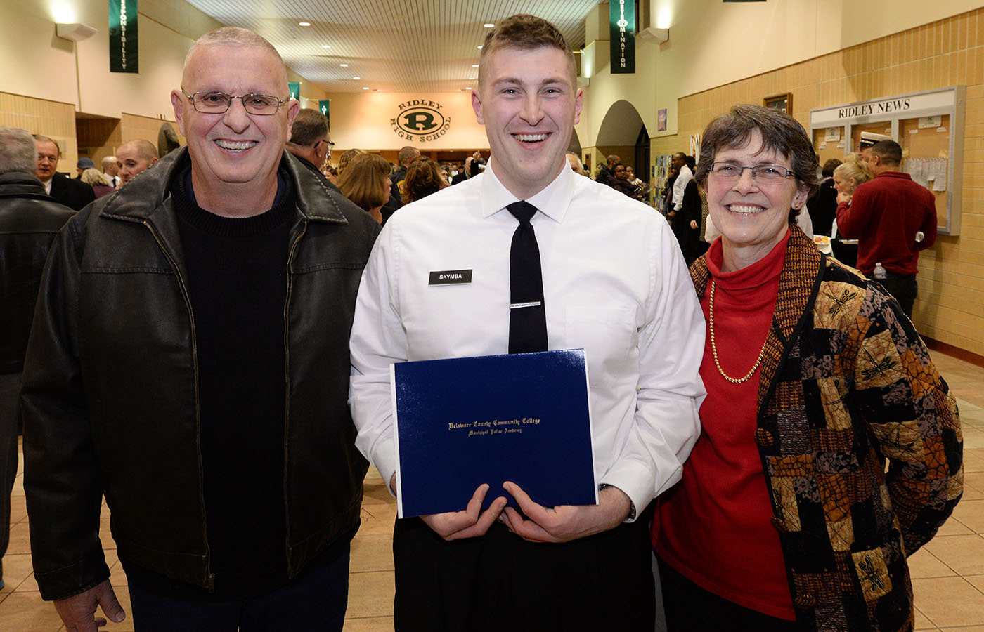 Police Academy graduate with family