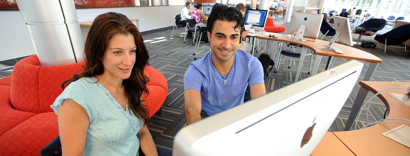 Image of students at a computer