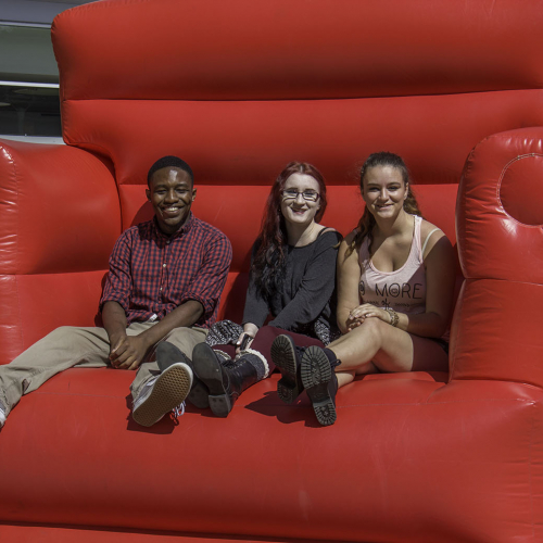 students on a gaint chair at 2015 Fall Open House
