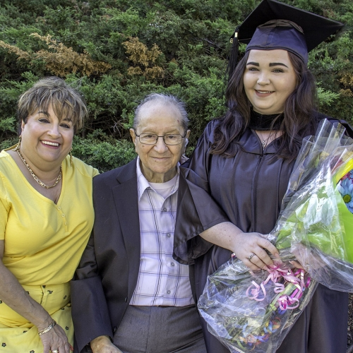 Graduate poses with family