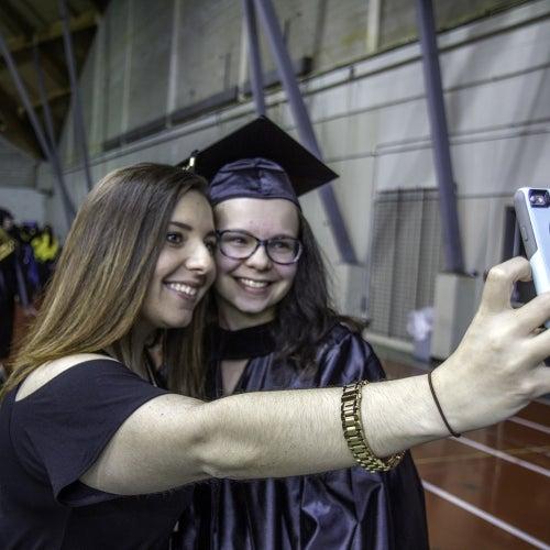 Graduate takes selfie
