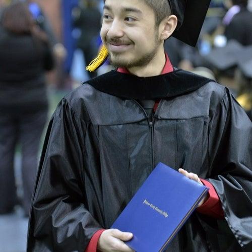 Graduate holds diploma