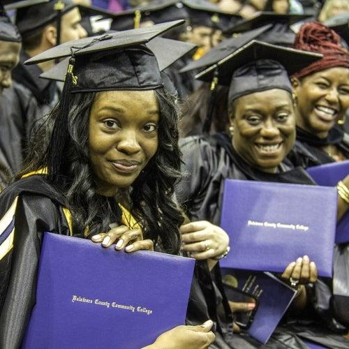 Graduates hold diplomas