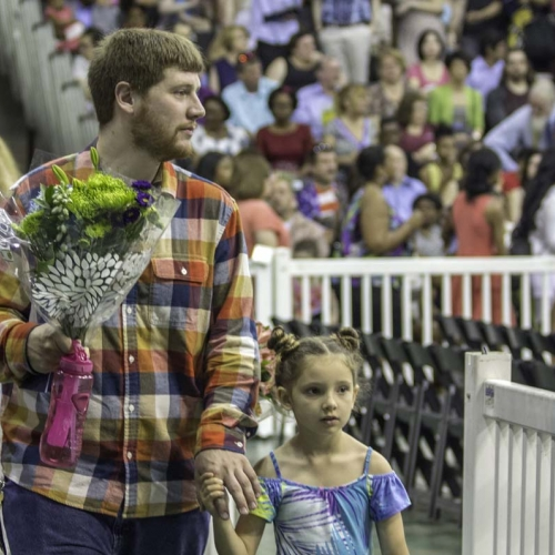 Relative of students holding flowers