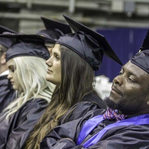 Graduating students listening