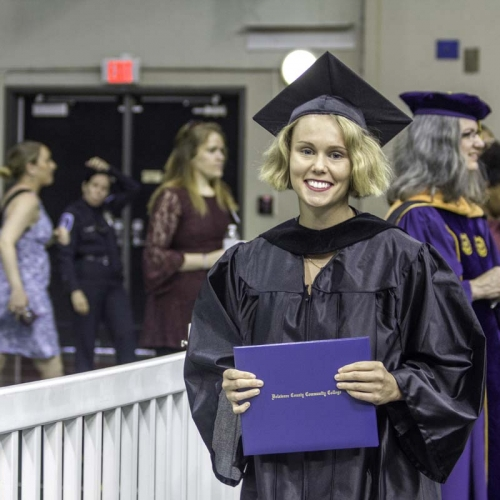 Student posing with diploma