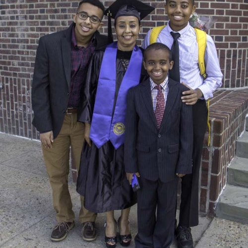 Student posing for picture with loved ones