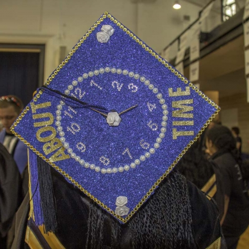 """Customized student cap with words, """"About time"""""""