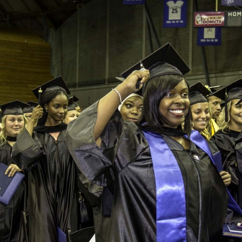Students turning tassels after graduating