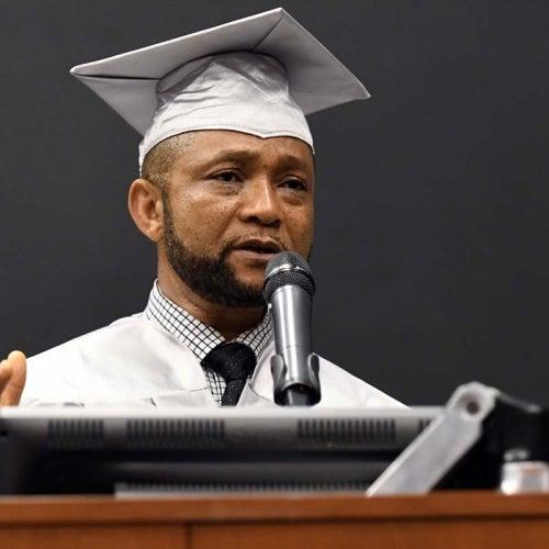 Graduate giving speach at podium.