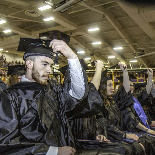 Grads move tassles on caps at end of ceremony