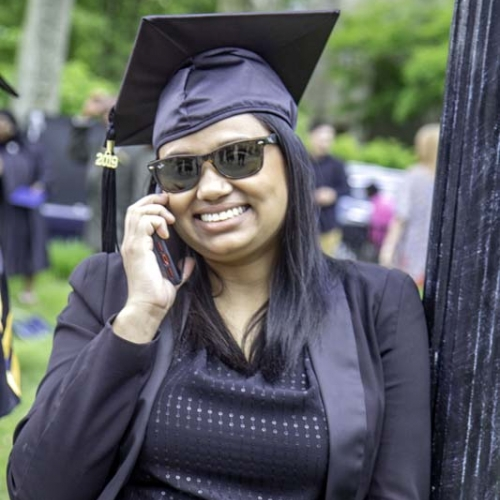 Graduate talking on the phone after graduation
