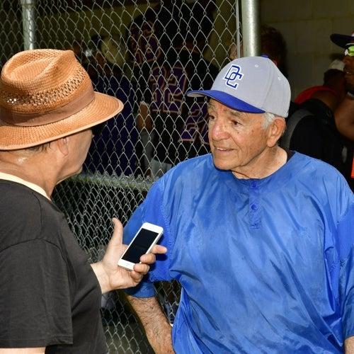 Coach Paul Motta being interviewed