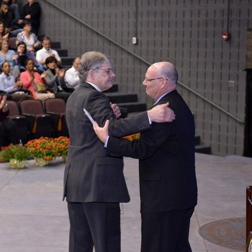 Jerry and John Glavin hug